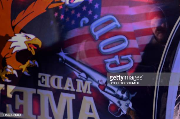 David Parrish a pro gun supporter from Richmond Virginia holds a pro gun banner in the grounds of the Virginia State Capitol grounds in Richmond...
