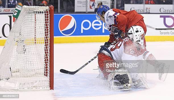 David Pasternak of Team Czech Republic slips the winning goal in overtime past Georg Sorensen of Team Denmark in the 2015 IIHF World Junior Hockey...