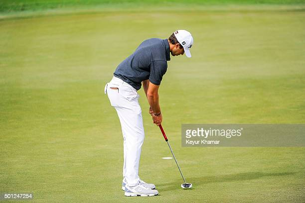 David Pastore makes a birdie putt on the ninth hole green of the Champion Course during the final round of Webcom Tour QSchool at PGA National Resort...
