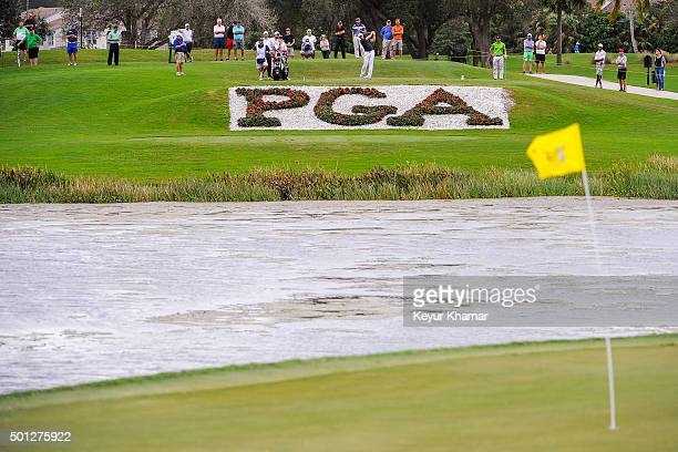 David Pastore tees off as strong winds bend the flagstick on the 17th hole green of the Champion Course during the final round of Webcom Tour QSchool...