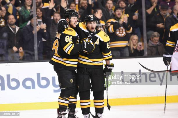 David Pastrnak and Brad Marchand of the Boston Bruins celebrate their goal against the Columbus Blue Jackets at the TD Garden on March 19 2018 in...