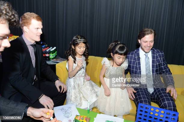David Pastrnak and Colby Cave play games with Emmy and Rosie at Champions For Children's benefitting Boston Children's Hospital at Seaport World...