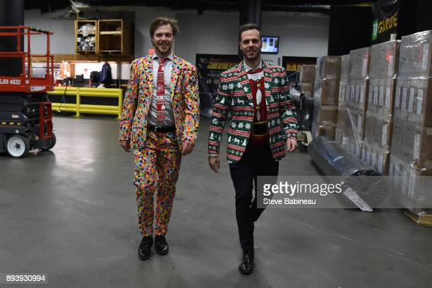 David Pastrnak and David Krejci of the Boston Bruins wearing holiday suits before the game against the New York Rangers at the TD Garden on December...