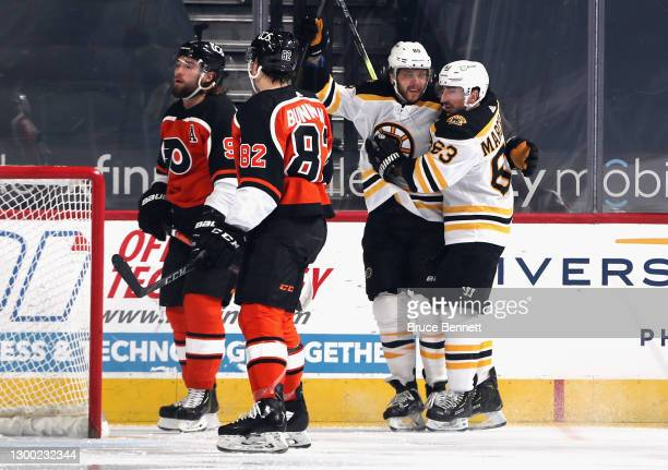 David Pastrnak of the Boston Bruins and Brad Marchand celebrate Pasternak's goal at 12 seconds of the first period against the Philadelphia Flyers at...