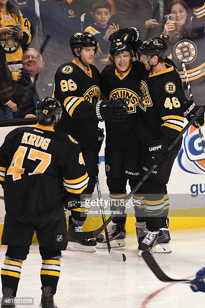 David Pastrnak of the Boston Bruins and his linemats celebrate a goal against the Tampa Bay Lightning at the TD Garden on January 13 2015 in Boston...