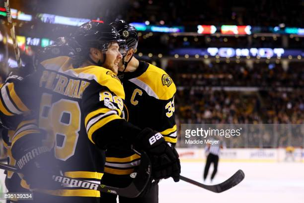 David Pastrnak of the Boston Bruins and Zdeno Chara celebrate after Brad Marchand scored a goal against the Columbus Blue Jackets during the first...