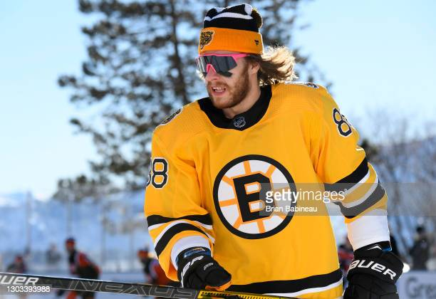 David Pastrnak of the Boston Bruins attends warm ups before playing against the Philadelphia Flyers in the 2021 NHL Outdoors Sunday presented by...