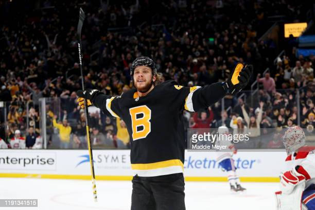 David Pastrnak of the Boston Bruins celebrates after scoring a goal against the Montreal Canadiens during the third period at TD Garden on December...