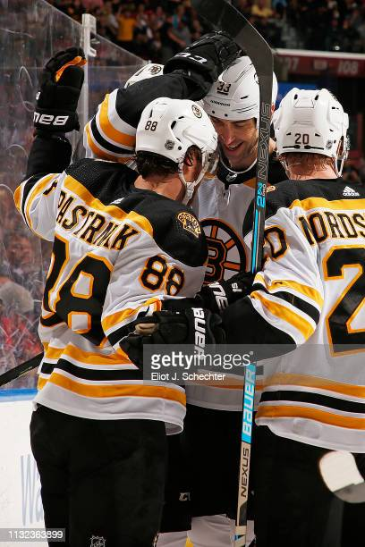 David Pastrnak of the Boston Bruins celebrates his goal with teammates during the second period against the Florida Panthers at the BBT Center on...
