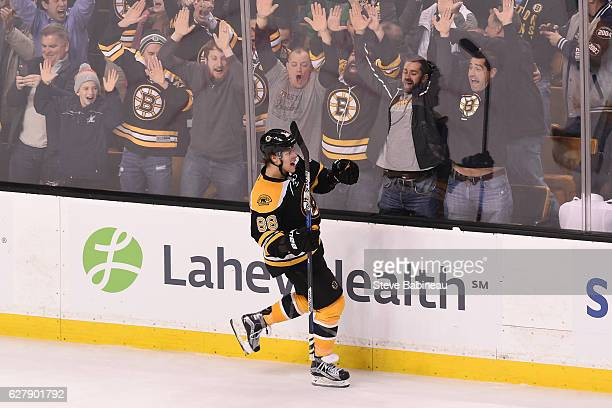 David Pastrnak of the Boston Bruins celebrates his overtime goal against the Florida Panthers at the TD Garden on December 5 2016 in Boston...