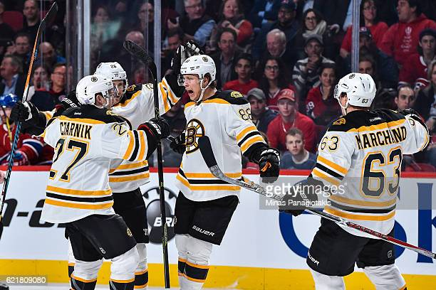 David Pastrnak of the Boston Bruins celebrates his third period goal with teammates during the NHL game against the Montreal Canadiens at the Bell...