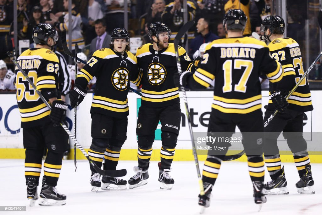 David Pastrnak #88 of the Boston Bruins celebrates with Brad Marchand #63, Torey Krug #47 and Ryan Donato #17 after scoring a goal against the Florida Panthers during the third period at TD Garden on April 8, 2018 in Boston, Massachusetts. The Panthers defeat the Bruins 4-2.