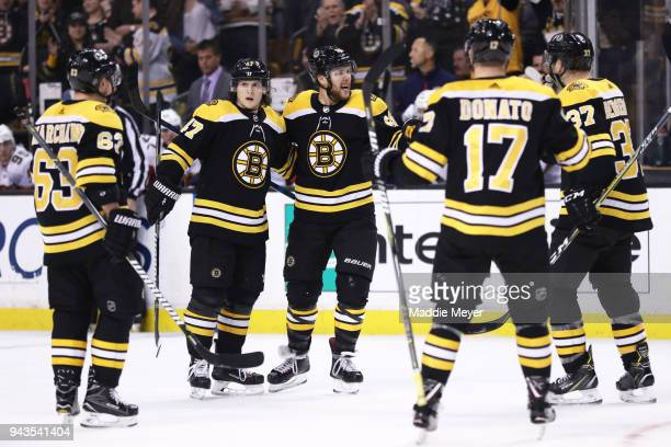 David Pastrnak of the Boston Bruins celebrates with Brad Marchand Torey Krug and Ryan Donato after scoring a goal against the Florida Panthers during...