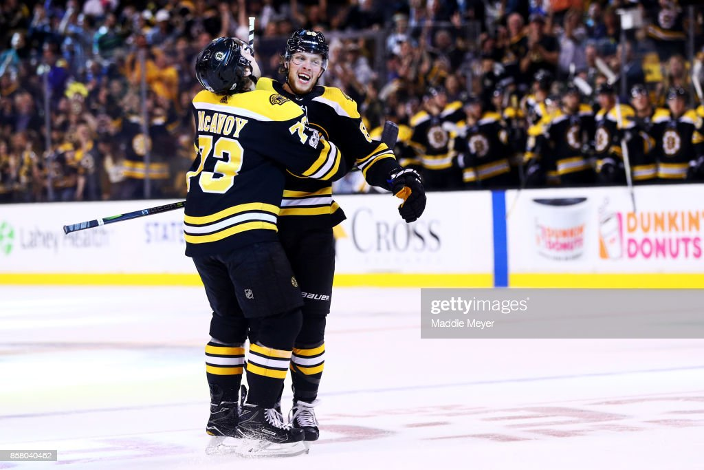 David Pastrnak #88 of the Boston Bruins celebrates with Charlie McAvoy #73 after scoring a goal against the Nashville Predators during the first period at TD Garden on October 5, 2017 in Boston, Massachusetts.
