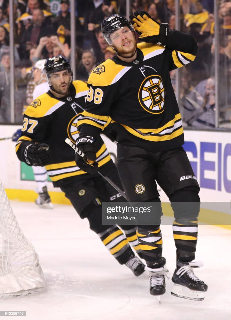 David Pastrnak #88 of the Boston Bruins celebrates with Patrice Bergeron #37 after scoring a goal against the Toronto Maple Leafs during the first period of Game Two of the Eastern Conference First Round during the 2018 NHL Stanley Cup Playoffs at TD Garden on April 14, 2018 in Boston, Massachusetts.