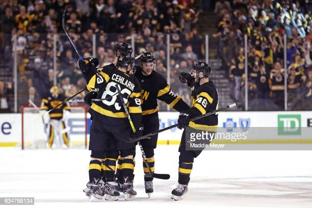 David Pastrnak of the Boston Bruins celebrates with Peter Cehlarik, Zdeno Chara and David Krejci after scoring against the Vancouver Canucks during...