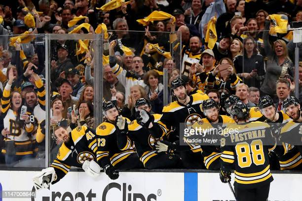 David Pastrnak of the Boston Bruins celebrates with teammates after scoring a goal against the Columbus Blue Jackets during the third period of Game...