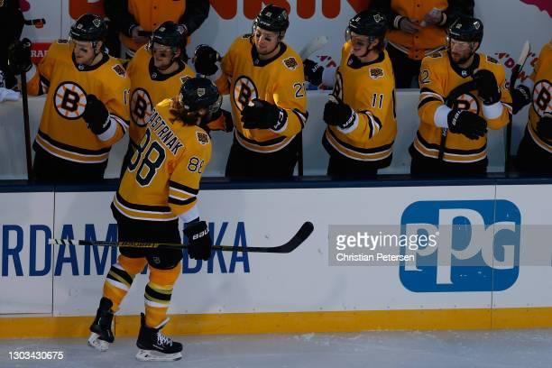 David Pastrnak of the Boston Bruins celebrates with teammates on the bench after scoring a first period goal against the Philadelphia Flyers during...