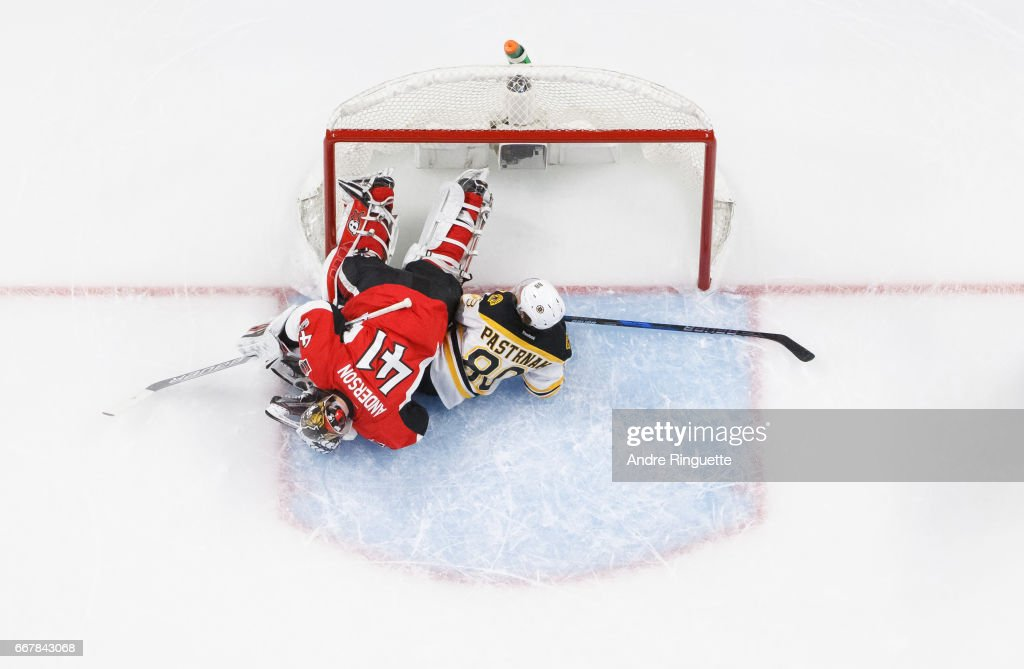 David Pastrnak #88 of the Boston Bruins collides with Craig Anderson #41 of the Ottawa Senators on a failed breakaway attempt in Game One of the Eastern Conference First Round during the 2017 NHL Stanley Cup Playoffs at Canadian Tire Centre on April 12, 2017 in Ottawa, Ontario, Canada.