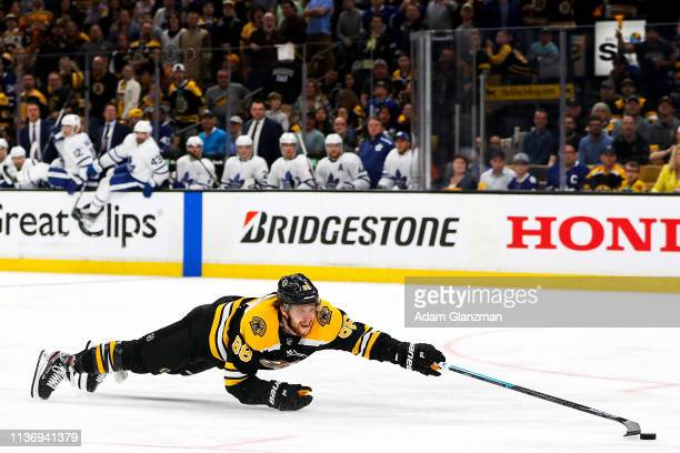 David Pastrnak of the Boston Bruins dives for a loose puck in yeti third period of a game against the Toronto Maple Leafs in Game Two of the Eastern...