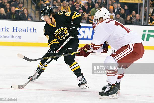 David Pastrnak of the Boston Bruins handles the puck against Henrik Samuelsson of the Arizona Coyotes at the TD Garden on February 28 2015 in Boston...