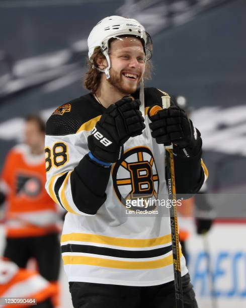 David Pastrnak of the Boston Bruins laughs while on the ice for warmups prior to his game against the Philadelphia Flyers at the Wells Fargo Center...