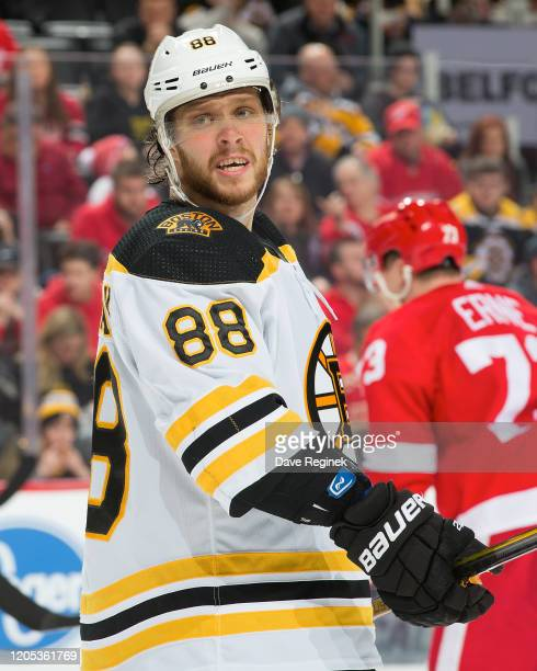 David Pastrnak of the Boston Bruins looks down the ice against the Detroit Red Wings during an NHL game at Little Caesars Arena on February 9, 2020...