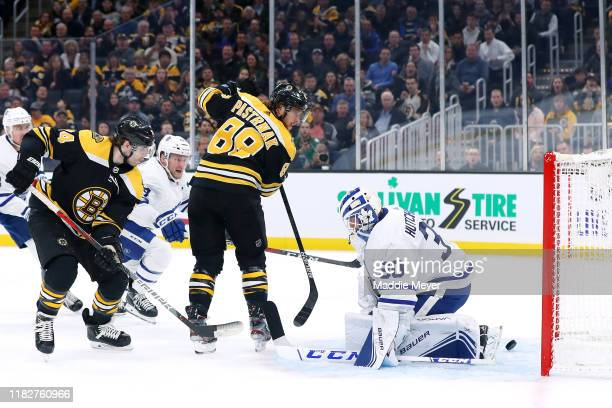 David Pastrnak of the Boston Bruins plays the puck between his legs to score a goal against Michael Hutchinson of the Toronto Maple Leafs during the...