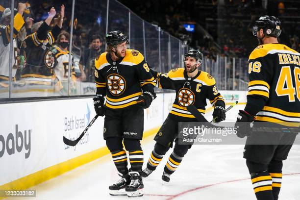 David Pastrnak of the Boston Bruins reacts after scoring in the third period of Game Four of the First Round of the 2021 Stanley Cup Playoffs against...