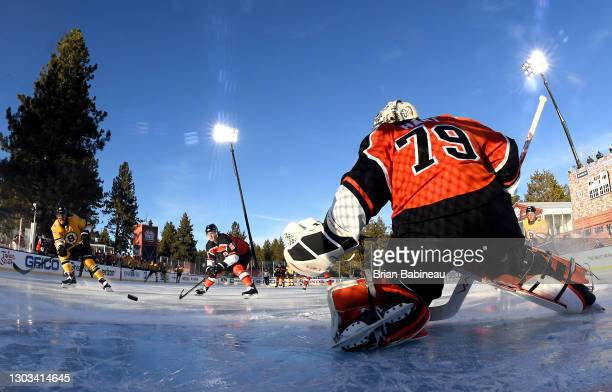 David Pastrnak of the Boston Bruins scores a goal on goaltender Carter Hart of the Philadelphia Flyers during the first period of the 2021 NHL...