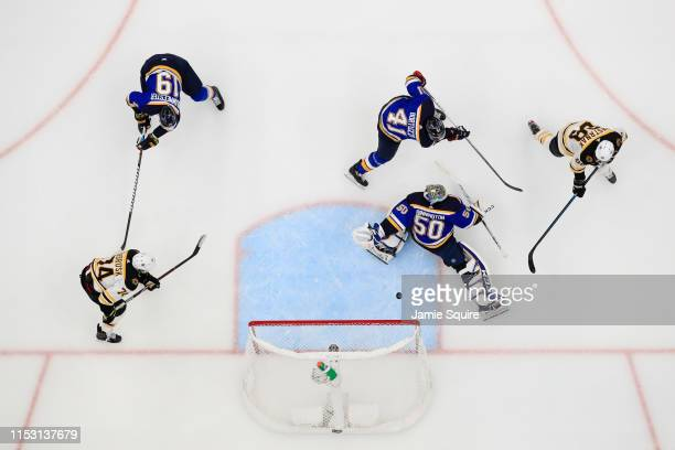 David Pastrnak of the Boston Bruins scores a second period goal past Jordan Binnington of the St Louis Blues in Game Three of the 2019 NHL Stanley...