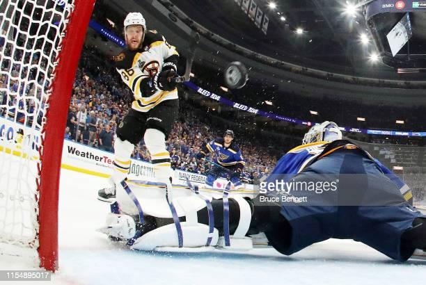 David Pastrnak of the Boston Bruins scores a third period goal past Jordan Binnington of the St. Louis Blues in Game Six of the 2019 NHL Stanley Cup...
