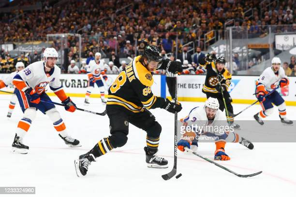 David Pastrnak of the Boston Bruins shoots the puck in the third period in Game Five of the Second Round of the 2021 Stanley Cup Playoffs against the...