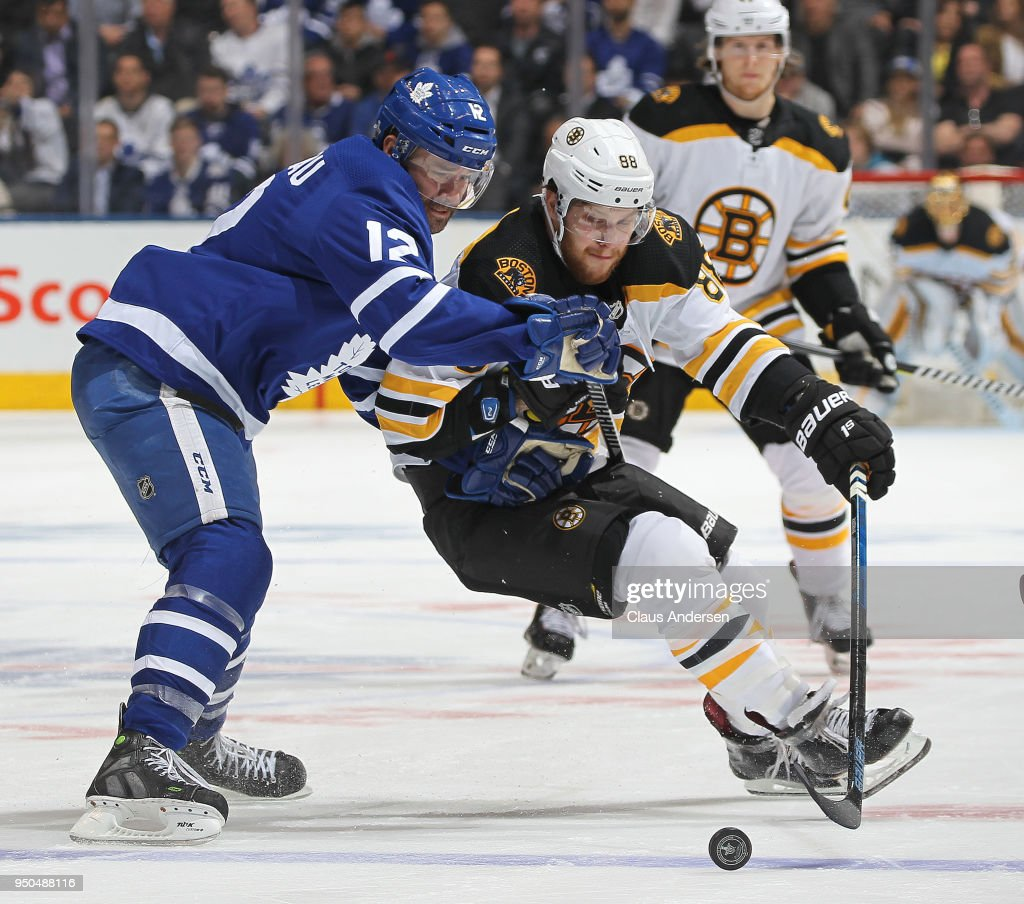 David Pastrnak #88 of the Boston Bruins skates against Patrick Marleau #12 of the Toronto Maple Leafs in Game Six of the Eastern Conference First Round in the 2018 Stanley Cup Play-offs at the Air Canada Centre on April 23, 2018 in Toronto, Ontario, Canada. The Maple Leafs defeated the Bruins 3-1.