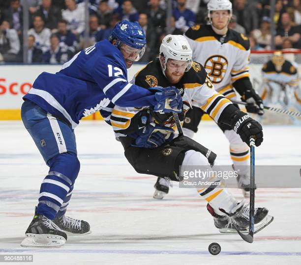 David Pastrnak of the Boston Bruins skates against Patrick Marleau of the Toronto Maple Leafs in Game Six of the Eastern Conference First Round in...