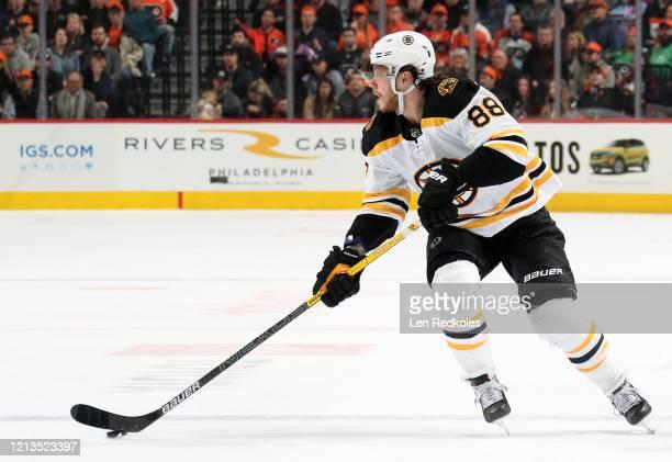 David Pastrnak of the Boston Bruins skates the puck against the Philadelphia Flyers on March 10 2020 at the Wells Fargo Center in Philadelphia...