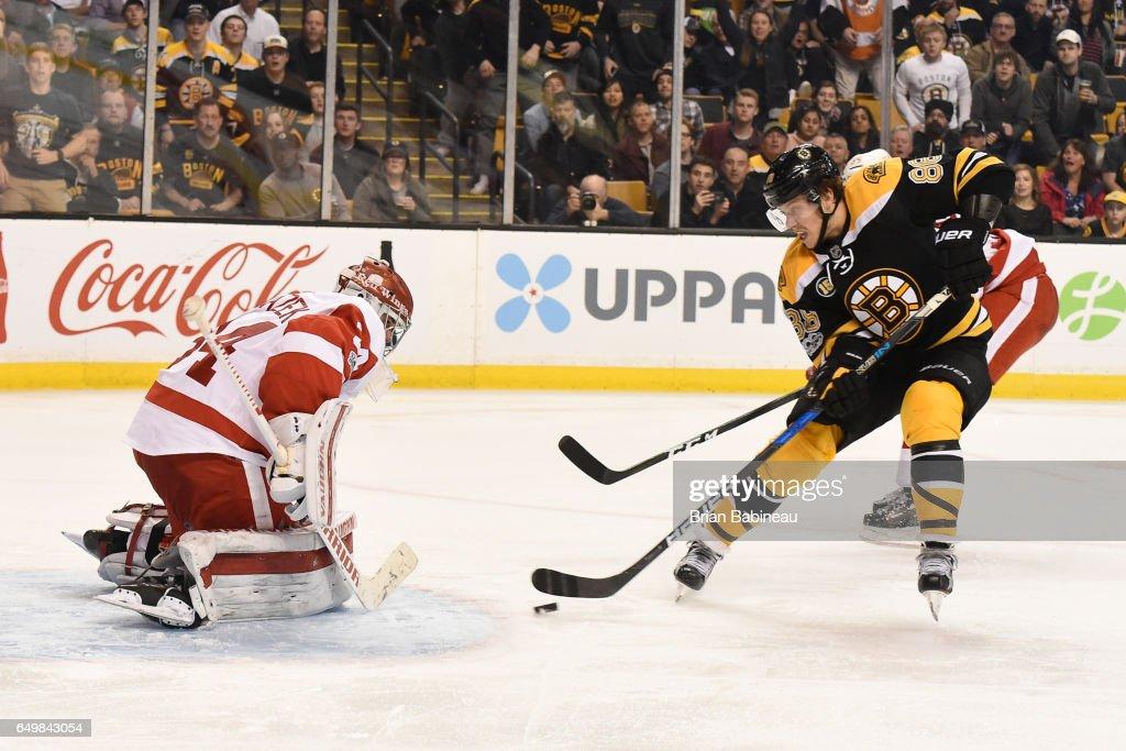 David Pastrnak #88 of the Boston Bruins skates towards Petr Mrazek #34 of the Detroit Red Wings at the TD Garden on March 8, 2017 in Boston, Massachusetts.