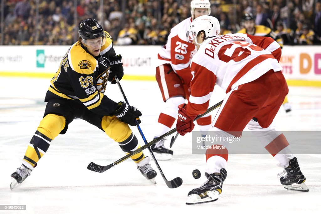 David Pastrnak #88 of the Boston Bruins takes a shot against Danny DeKeyser #65 of the Detroit Red Wings during the third period at TD Garden on March 8, 2017 in Boston, Massachusetts. The Bruins defeat the Red Wings 6-1.