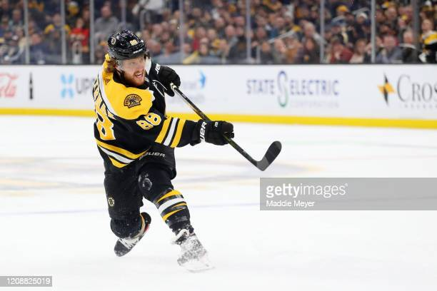 David Pastrnak of the Boston Bruins takes a shot against the Calgary Flames during the first period at TD Garden on February 25, 2020 in Boston,...