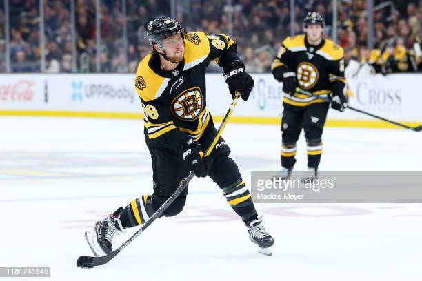 David Pastrnak of the Boston Bruins takes a shot on goal during the third period of the game against the Tampa Bay Lightning at TD Garden on October...