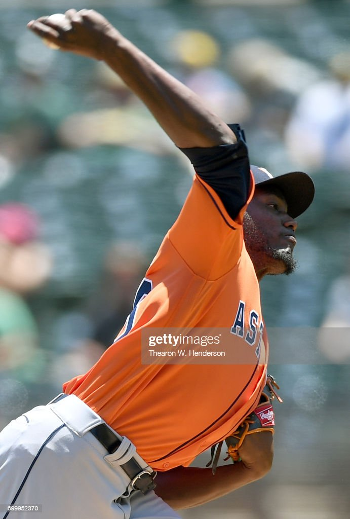 David Paulino #63 of the Houston Astros pitches against the Oakland Athletics in the bottom of the first inning at Oakland Alameda Coliseum on June 22, 2017 in Oakland, California.