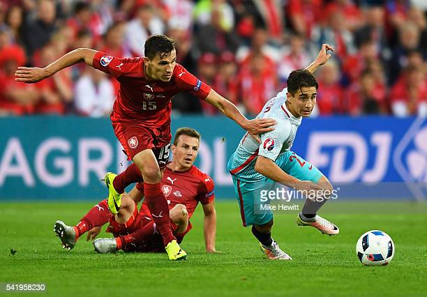 David Pavelka of Czech Republic tackles Emre Mor of Turkey during the UEFA EURO 2016 Group D match between Czech Republic and Turkey at Stade...