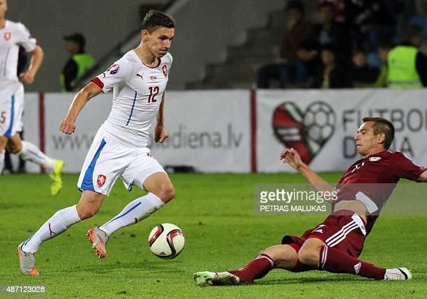 David Pavelka of Czech Republic vies with Latvia's Vladimirs Kamess during the Euro 2016 qualifying football match between Latvia and Czech Republic...