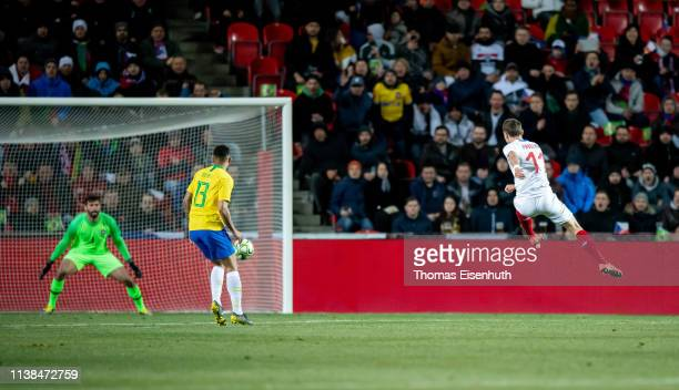 David Pavelka of the Czech Republic scores the opening goal past goalkeeper Alisson Becker of Brazil during the international friendly match between...