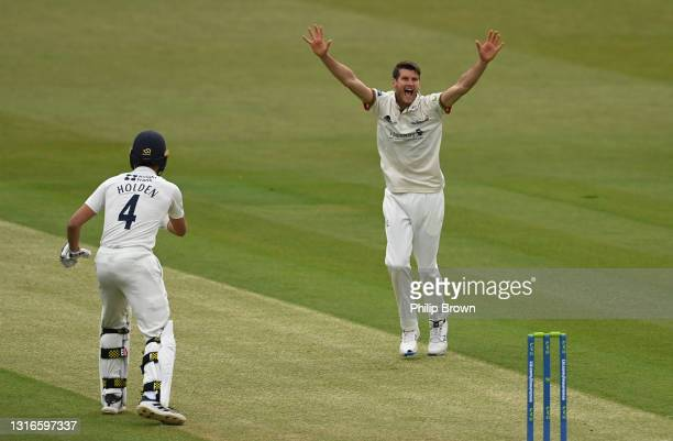 David Payne of Gloucestershire appeals for the dismissal of Sam Robson as Max Holden of Middlesex looks on during day one of the LV= Insurance County...