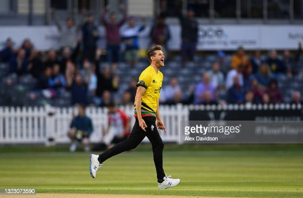 David Payne of Gloucestershire celebrates taking the wicket of Ravi Bopara of Sussex during the Vitality T20 Blast match between Gloucestershire and...
