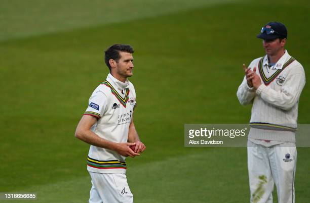 David Payne of Gloucestershire walks off after taking 5 wickets during Day One of the LV= Insurance County Championship match between Middlesex and...