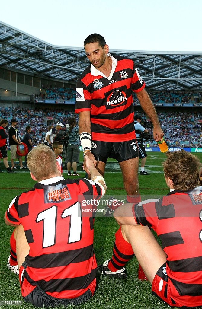 David Peachey of the Bears shakes hands with team-mate Shannan McPherson after the 2007 Premier League Grand Final between the Parramatta Eels and the North Sydney Bears at Telstra Stadium September 30, 2007 in Sydney, Australia.