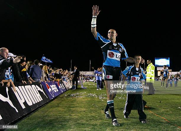 David Peachey of the Sharks farwells the crowd after playing his last home match the Round 26 NRL match between the Cronulla Sutherland Sharks and...