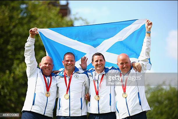 David Peacock, Neil Speirs, Paul Foster, and Alex Marshall of Scotland celebrate with their medals after winning the Gold Medal in the Men's Fours...